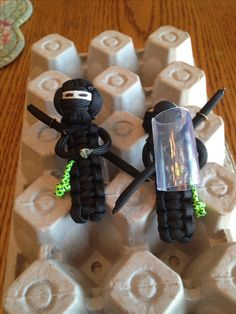 """Cool bowing paracord ninjas! Monkey fist for the head and cobra stitch for the body. Each ninja has a small knot attached to their side. I'm using these as """"the knot ninja slide award"""". For Boy Scouts that have earned the right of being the knot ninja for our troop!"""