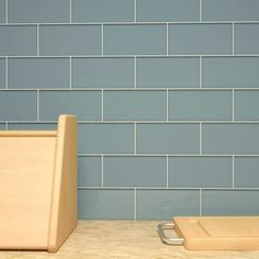 The popular Slate Subway tiles offer a modern look in a light color, great for accenting stainless appliances as a kitchen backsplash. These glass tiles will also be perfect in a bathroom for an upscale executive look. Subway Tile Colors, Grey Subway Tiles, Glass Subway Tile, Color Tile, Glass Tiles, Subway Backsplash, Stone Backsplash, Subway Tile Kitchen, Kitchen Backsplash