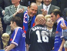 French President Jacques Chirac (C rear) congratulates goalkeeper Fabien Barthez (#16) as Bixente Lizarazu (L) holds the FIFA trophy and midfielder Zinedine Zidane (R) looks on12 July at the Stade de France in Saint-Denis, near Paris, after France defeated Brazil 3-0 in the 1998 Soccer World Cup final.