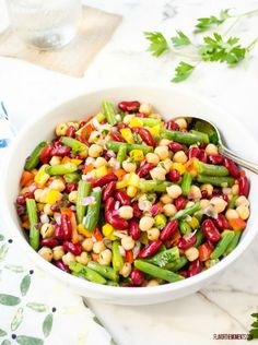 Fresh and Easy Three Bean Salad is packed with goodness and a lightened up dressing. It's the perfect side for picnics and barbecues!