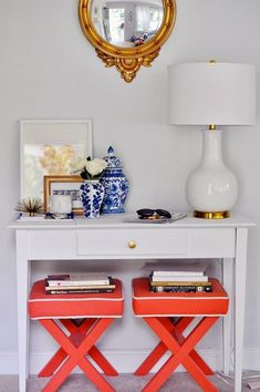 Share Tweet + 1 Mail There is something about the look of two ottomans tucked under a console table that I love. It could ...