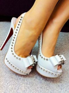 623d3577aa80 louboutin white studded peep toe pumps with bows