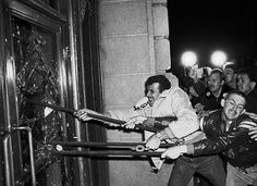 Gay men smash windows at the San Francisco City Hall in 1979 to protest the involuntary manslaughter verdict handed down to Dan White, the man who killed Harvey Milk.