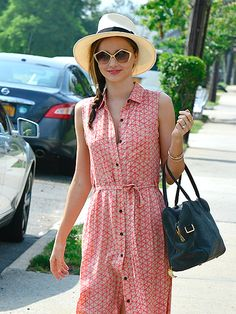 Miranda Kerr was a true vision in a straw hat and printed tank dress topped off with metallic gold geometric sunnies! It's the perf look for a summery weekend outing!