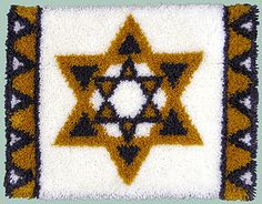 """Star of David Rug. Finished size 27x20"""". Kit includes chart, how-to-instructions, Latch hook canvas with blue lined grid and Pre-cut acrylic yarn."""