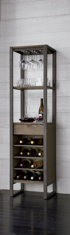 This all-in-one wine tower promises to be the center of the party. Crafted of ash veneer with a warm charcoal finish, this tall storage piece provides airy and open shelves to rack stemware and provide easy access to barware and bottles. A drawer at midpoint keeps recipes and bar tools tucked away, while down below, a wine grid stows up to 16 bottles…