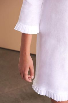 Feminine, classic and all things pretty is the message with the white linen Jamyla dress. Fácil Blanco is proudly designed and tailored in Dubai from Italian linen. Effortless Chic, Feminine Dress, Linen Dresses, Hemline, Cheer Skirts, One Piece, Fashion Outfits, My Style, Pretty