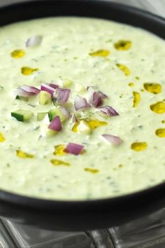 This cool, refreshing cucumber soup from Andrew Zimmern gets tang and creaminess from Greek yogurt and big, summery flavor from lots of fresh herbs.#cucumbersoup #cucumbers #soup #souprecipes #foodandwine Wine Recipes, Kitchen Recipes, Soup Recipes, Veggie Recipes, Great Recipes, Vegetarian Recipes, Healthy Recipes, Cucumber Soup Recipe, Cucumber Yogurt