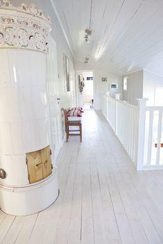 white hallway. Swedish stove.