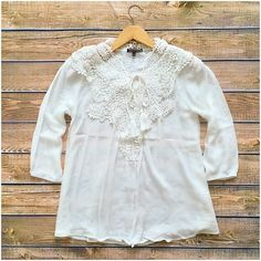 LISTING! NWT Boho Gauzy Crochet Lace Top NWT Crochet Lace Gauzy Top. Beautiful light, romantic top! Off white, with crocheted lace details at neckline and around shoulders. Front tie, 3/4 length sleeves. Material is Rayon. Fits true to size, available in S (0-4), M (6-8), L (10-12). No Trades and No Paypal Tops Blouses