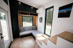 """The Lykke by Wind River Tiny Homes is a 24 ft tiny house on wheels. Lykke is the Danish word for """"happiness"""". This house features the warmth of Danish interior design. Tiny Houses For Sale, Tiny House On Wheels, Black Walls, White Walls, Mini Wood Stove, Loft Railing, Tiny Home Cost, Danish Interior Design, Herringbone Wood Floor"""