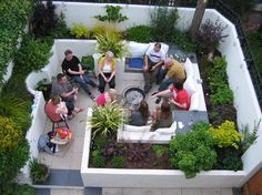 Modern backyard courtyard renovation by Katherine Edmonds Garden Design. The entrance has steps, so it's not wheelchair accessible, but I still like the use of built-in benches among the raised beds. It's like an updated conversation pit relocated outside. Follow the link to view before/after photos and the blueprint for the space.
