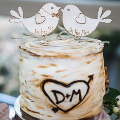 nice vancouver wedding // Look at this adorable cake topper by @delectableevents!  I think that Rebecka at Delectable Events did an amazing job creating the cake topper based on this wedding's rustic theme! Also, those birdies!   by @winkphotography  #vancouverwedding #vancouverweddingcake #vancouverwedding