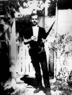 The Famous Backyard Photo Of Lee Harvey Oswald Which Many Believe To Be A Fake.1963