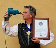 """UNIVERSAL RECORDS FORUM """"The Human Toolbox"""" certificate and medal. Brad Byers was the first to use an electric drill in the classic """"blockhead"""" sideshow act."""