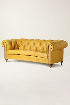 Anthropologie. If I can't have an old weathered caramel leather chesterfield with separate bottom cushion, a creamy yellow one would do… but sadly not at $6000.