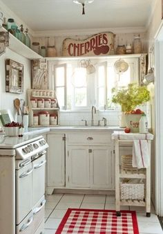 Beautiful white country kitchen with red and blue accents