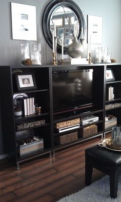 Baskets + Trays + Frames from HomeGoods help keep a wall unit organized & #HomeGoodsHappy!  Lynda Quintero-Davids #sponsored