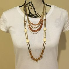 SALE Amber and gold necklace set Only worn a few times, looks great with white and any color work pants or jeans. The back clasps are adjustable and have a small amount of tarnish Charming Charlie Jewelry Necklaces