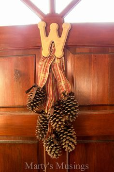 Pinecone door arrangement and tons of other thrifty fall decor ideas.