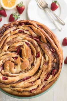 Giant Strawberry Cinnamon Roll Cake is the perfect breakfast or brunch recipe! It's an easier recipe than it looks, filled with fresh strawberries.