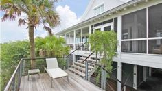 23 Seagrass Ln, Isle Of Palms, SC 29451 - Architecturally, 23 Seagrass Lane is one of the most interesting and unique homes in the Charleston area, and the private, marsh front location and views are exceptional! The building style is all post and beam construction, and it was custom...