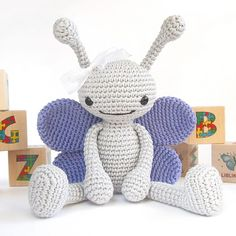 Ravelry: Crocheted butterfly pattern - Anthropomorphized butterfly - Amigurumi tutorial with photos - Stuffed animal pattern - Cute soft toy - Baby shower pattern by Kristi Tullus.  So cute!