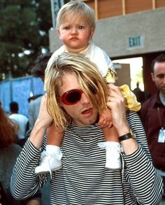 Kurt Cobain carries Frances Bean Cobain on his shoulders outside of the 10th Annual MTV Video Music Awards on September 2, 1993.