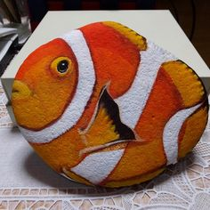 Clown fish painted on a rock.