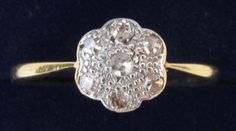 Art Deco platinum and gold daisy diamond ring. Via Diamonds in the Library.