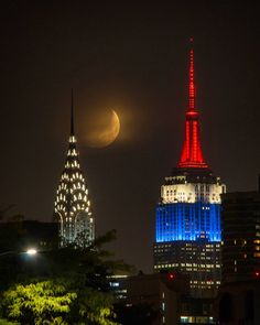 Max Guliani - moonset between the Chrysler and Empire State Building from Queens, NY