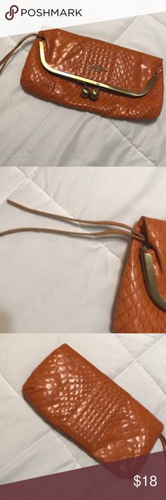 """Jessica Simpson clutch Good condition, orange with brass colored hardware, measures 12""""7""""1 (closed) Jessica Simpson Bags Clutches & Wristlets"""