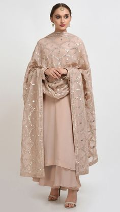 From our Wedding and Bridal Collection, this is an oyster pink pure crepe suit with intricate exquisite silvery gold gota patti and gold dabka work hand embroidery. The gota patti embroidered on the shirt at front-back neckline and sleeve ends. Indian Wedding Outfits, Pakistani Outfits, Indian Outfits, Indian Dresses, Indian Attire, Indian Wear, Indian Designer Suits, Desi Clothes, Indian Clothes
