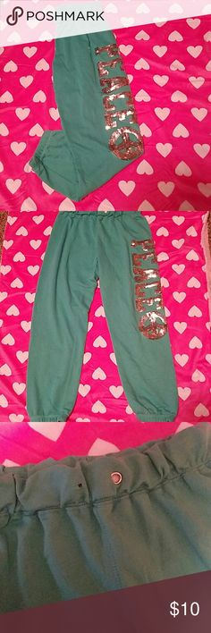 Joe boxer sequined sweat pants Super cute and comfortable joe boxer teal CROP sweatpants with sequined lettering that says peace with a peace sign. Only faults is the string missing and the silver ring where the string comes through. Other than that no stains or rips. joe boxer Pants