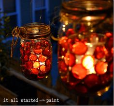 mason jar votive with red beads Place votive in jar, slide glass beads in space between jar and votive wrap picture wire around the top of jar for hanging, cover w/ twine or ribbon.