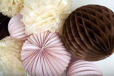 Meringue pompoms, powder pink accordian lantern and chocolate honeycomb balls by Sous le Lampion for weddings