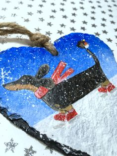 Dachshund Christmas Decoration Dachshund Christmas Slate Beautiful hand painted Christmas decoration, a cute little black and tan sausage dog on the snow with his friend Mr Robin. Perfect little decoration for the festive season, also makes a lovely gift for a Dachshund lover.