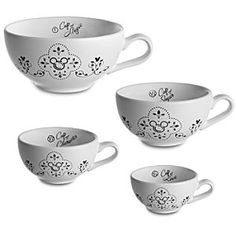 WANT WANT WANT       Disney Gourmet Mickey Mouse Measuring Cup Set -- 4-Pc. | Disney StoreGourmet Mickey Mouse Measuring Cup Set -- 4-Pc. - By any measure, Mickey's a household favorite so make him feel at home in the kitchen with this four-piece set of ceramic measuring cups. Featuring conventional calibration, these cups also list other measurements: Love, Character, Sugar and Magic.