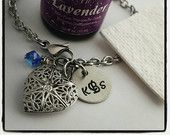 Essential oil diffuser bracelet with personalized disc and birthstone.