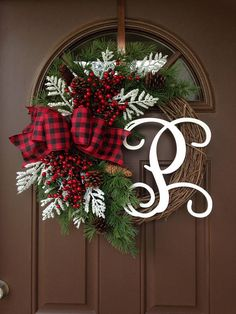 Picture#4 shows script alphabet (12) Picture #5 shows curly alphabet ( 8) ***The style of the wreath pictured is 12 white script.*** The Holiday season is upon us and this rustic wreath will make a great addition to your holiday decor . It will also make a great gift for a Birthday,Wedding ,Anniversary ,Housewarming and Christmas . Made on 18 grapevine base with faux evergreen branches ,accented with pine cones and red berries,finished with large bow. Add monogram of your choice for a…