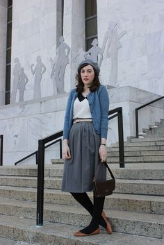 Vintage items can occasionally run the risk of looking a bit too antiquated but, in this instance, I love how so many timeless items are paired to create an appropriately bundled-up look and the muted blue hues of the cardigan and hat are just dreamy.