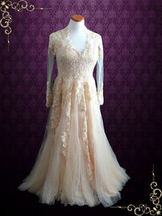 Vintage inspired lace wedding dress, a modified version of our popular style Korynne.Finished with a short sweeping train. Photoed in Blush. This dress can also be made in all ivory or another color of your choice. Working Time: 8-10 weeks Rush Order please inquire prior to order.   CustomDesigns We specialize in custom design services.If there's a dress you like and it's not on our website,you're more than welcome to email us a picture of the dress for a quote.info@ieieshop...