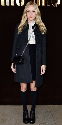 The eternally hip cool-girl Chloe Sevigny sat front row at the Miu Miu fall/winter 2016 show during Paris Fashion Week in a Miu Miu look that felt like a quirky twist on preppy—a white lace button-down tucked into a black pencil skirt that was styled with a clean gray coat, a chain-strap cross-body, knee-high socks, and chunky lace-ups