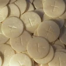 The bread I received at my first communion and every communion after that. It represents receiving the body of Jesus Christ.