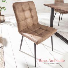 Hier treffen zeitloses Design und hoher Sitzkomfort aufeinander! Der Stuhl MODENA überzeugt mit einem schlichten Look, welcher wunderbar vielfältig kombiniert werden kann. Die bequeme Sitzschale ist komfortabel gepolstert und über die gesamte Fläche mit einer auffälligen Steppung verziert. Die schwarzen Beine im Retrostil bilden einen stimmigen Kontrast und sorgen für einen sicheren Stand auf jedem Untergrund.