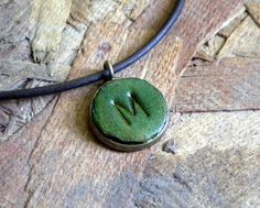 Leather Pendant Necklace Custom Stamped Initial Made to Order by TheLazyHleather on Etsy https://www.etsy.com/listing/75202827/leather-pendant-necklace-custom-stamped