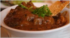 My easy Lamb Curry... A hearty, flavorful sauce with tender morsels of lamb, potatoes and peas.