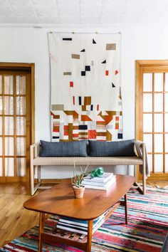 This wall is like a shrine to some of my favorite designers (all of whom happen to be my good friends). The quilt was made by Gina Rockenwagner and is inspired by an exhibition on Cuban Modernism I saw in Chelsea. The paper cord bench is a custom piece by Paul Mignogna of Stillmade, and the pillows are custom made from vintage Chinese homespun textiles by Claire Russo of Luru Home.