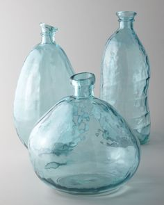 """These translucentTurquoise Glass Vases with allover """"hammered"""" texturing are handmade of recycled glass. That texturing, created by by """"bubbling"""" and imperfections inherent to recycled glass, adds unique vintage appeal. $55-$70. Buy here. Related posts: No related posts."""