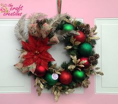 Items similar to Beautiful Christmas wreath-red poinsettia decor-golden leaves and feathers-green red ornaments-cone pine- on Etsy